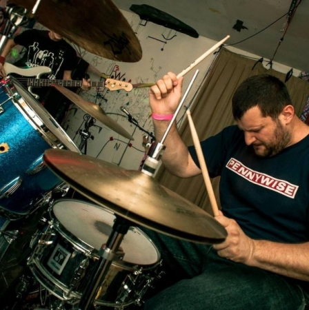 John playing drums with Tesla's Revenge, former local punk band.