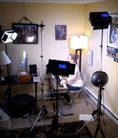 What a lesson looks like with lighting.   There is a camera that is over the piano keyboard so that piano student's can see the keys