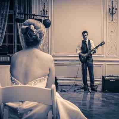 Playing electric guitar and singing to my wife on our wedding day