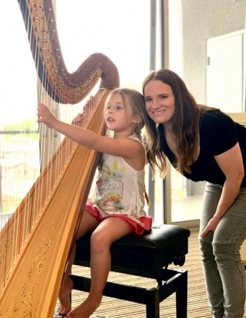 With a student at her harp lesson
