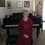 Mrs. Franke at home by her Yamaha Grand Piano