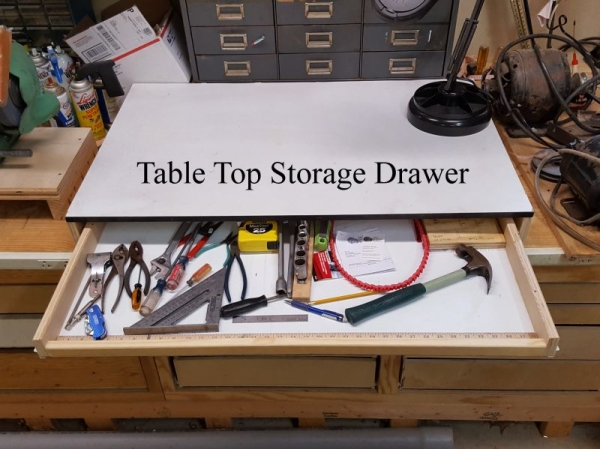 You can add drawers on the top of tables too.