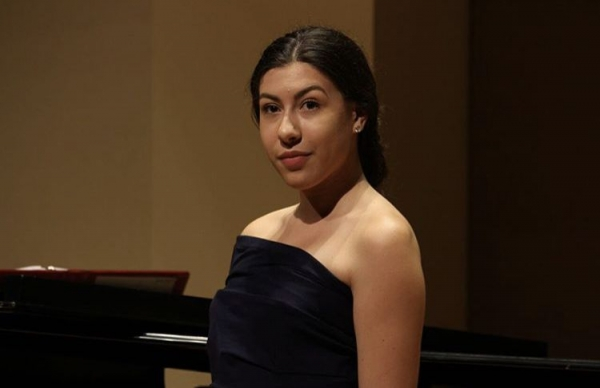 Olivia performing in a recital at the University of Toronto.