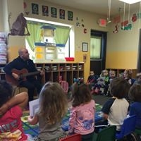 Working on social, coordination, focused attention and singing skills through group-based music lessons. So fun!