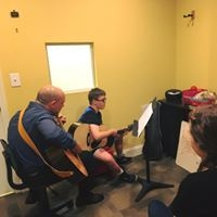 Working on reading/communication, singing, music reading and guitar skills. This kid is good!