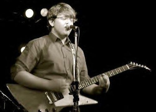Playing and Singing with a band, back when my hair was shorter!