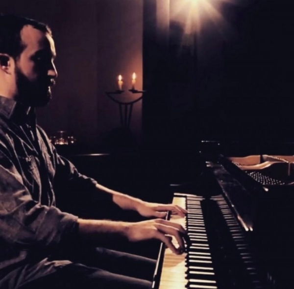 A screenshot from a video of my living room performance of Chopin's Ballade in F minor, Op. 52