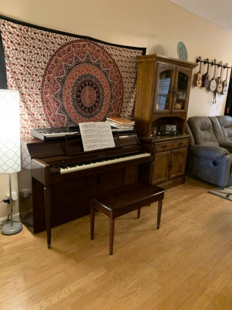 My living room piano. Acrosonic built by Baldwin. Also my ukuleles displayed on the wall
