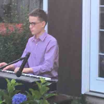 The annual outdoor cafe recital with Elijah performing