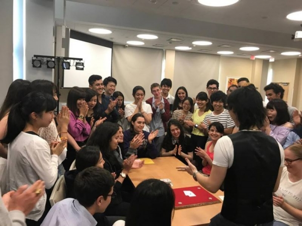 Close up magic show for international students at Saint Michael's College
