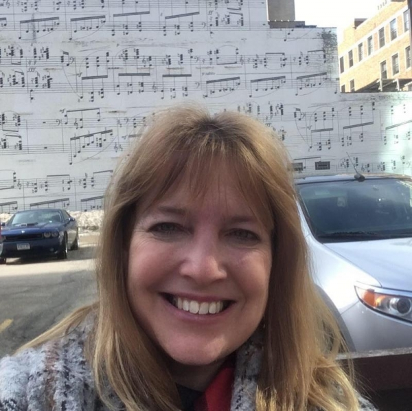 In front of the famous music score mural in Minneapolis