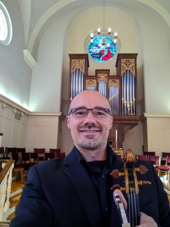 Getting ready to perform a chamber concert at a church.
