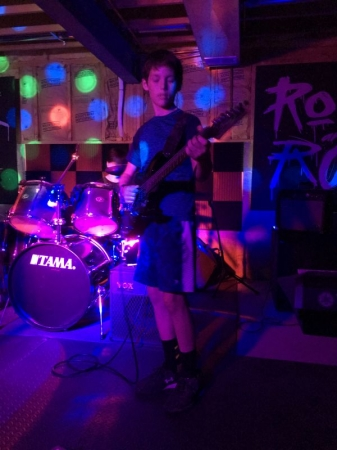 Dawsen playing lead guitar at one of the jam sessions