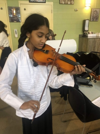 Getting ready for an audition at Jr. All District! She made it into the first violin section of the top orchestra! Way to go!