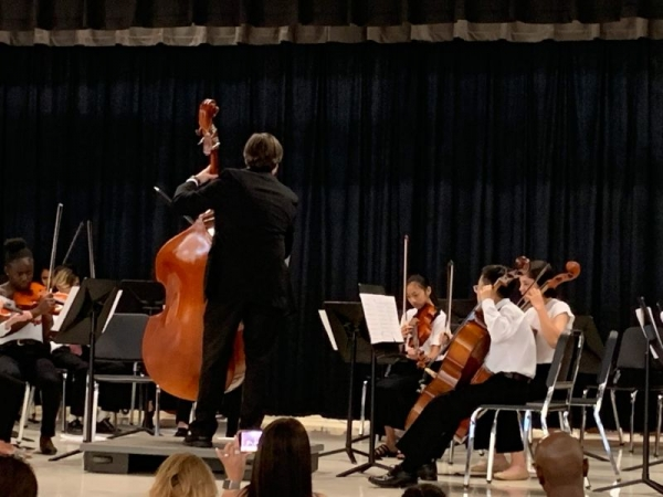 Performing with one of my orchestras. Sadly they didn't have a bass player so I got to fill in!