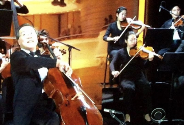 On stage with Yo-Yo Ma. (This is a picture of a tv screen so my apologies for the photo quality!)