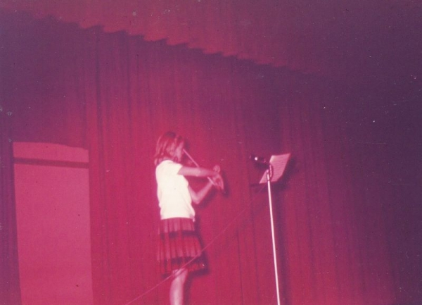 This is the first picture of Lois Owsley performing  in  6th grade.