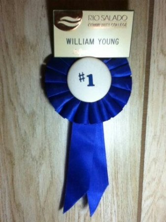Rio Solado College certified professor's identification badge and blue ribbon given to Mr. Young from his college students.