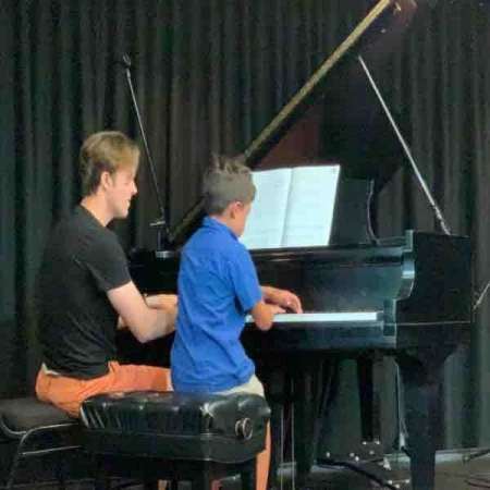 Recital day with students. Playing duets are fun!
