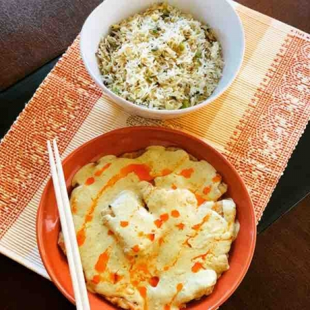 Burnt garlic Egg fried rice and creamy Fish in chilli oil