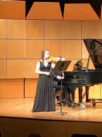Performing a recital in the finals of a competition.