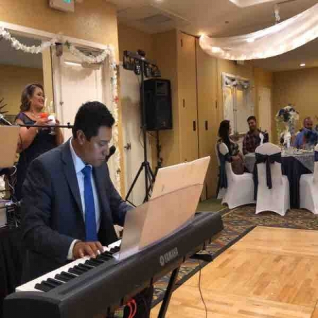 Playing at a wedding dinner reception.