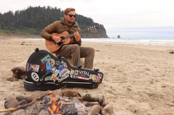Playing guitar on the Oregon Coast with friends
