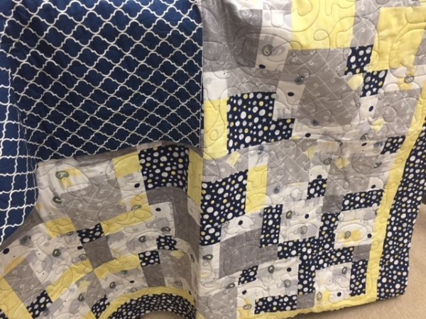Baby quilt with great long arm quilt design