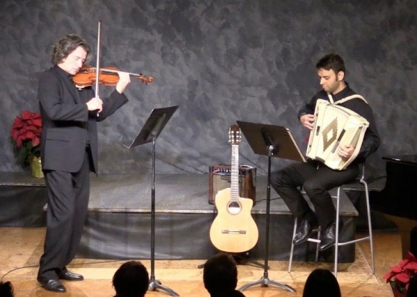 Playing accordion and guitar as part of a duo.