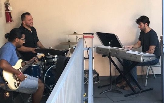 Playing piano in a jazz trio.