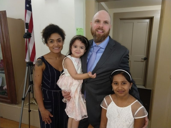 My wife, daughter, myself, and one of my students from our 2019 piano recital.