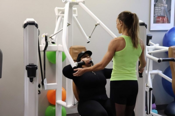 Me assisting one of my clients during a private session.