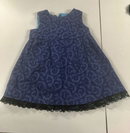 Toddler dress made by my student - They learn how to sew pleats, shirring, add lining to the dress and add trims.