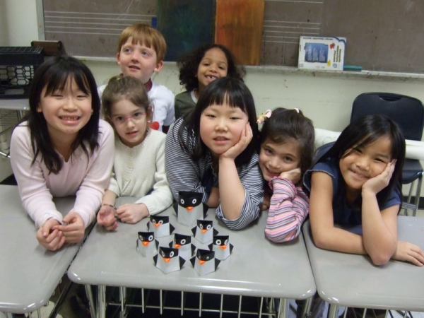 children with an origami Pinguin they have folded