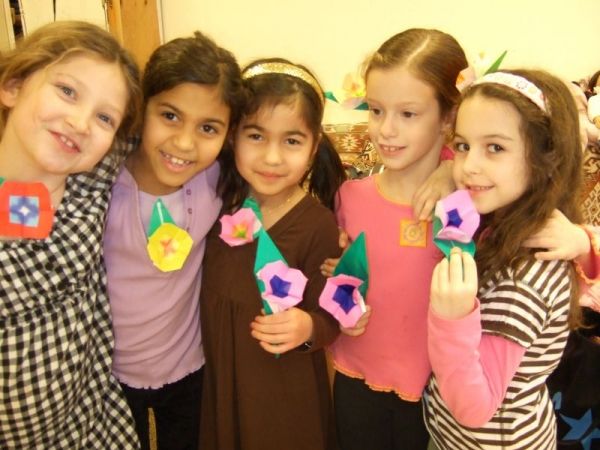 Girls with an origami flower they have folded