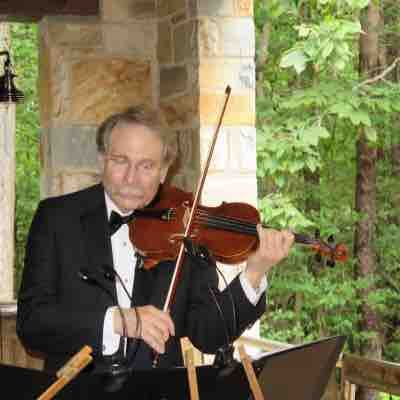 Outdoor wedding performance for former orchestra student and family