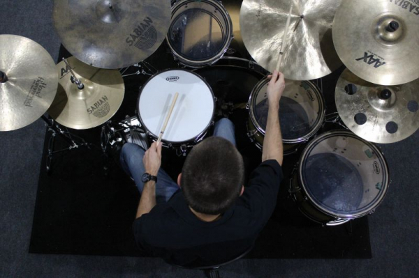 This is from a photo shoot in my home studio doing one of my favorite things, playing the drums!