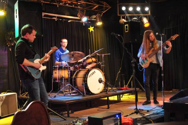 Performing at a local venue with my band, Otic Collusion.