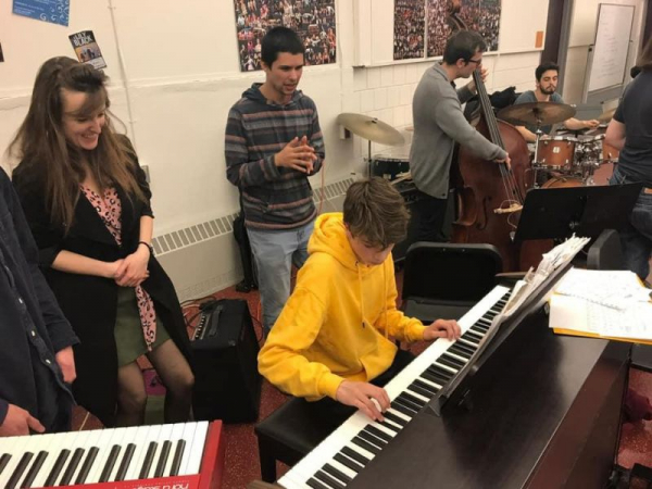 Teaching World and Jazz Music Ensemble at the Cambridge Rindge and Latin School in Cambridge, MA in 2019