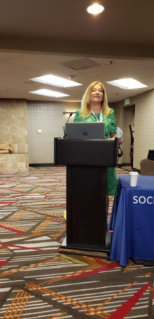 Beth Lurie lecturing at Denver conference (6/19)