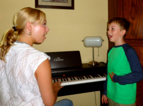 Paloma teaching Andy (8 years old) how to sing using his diaphragm