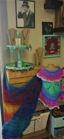 I love this beautiful shawl and toddlers circle vest. Sign up for crochet lessons to learn how to make things like this!
