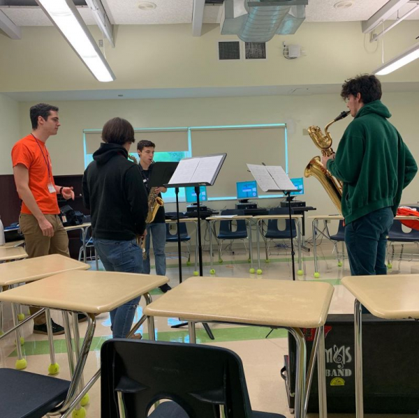 Me (orange shirt) coaching a high school saxophone quartet Summer 2019. Great kids!