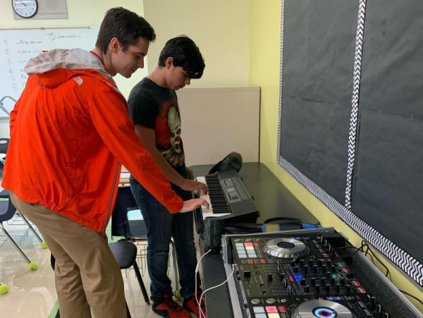 Teaching a 9th grade student basic keyboard improv patterns for his mixing.