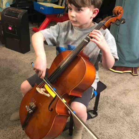 Octavius playing Cello with wonderful bow grip and posture