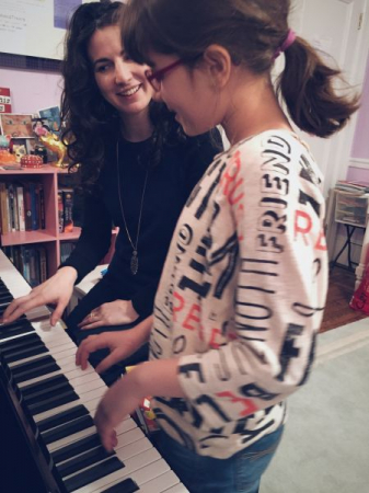 Me teaching Sarah, a wonderful piano and voice student.