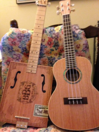 My ukulele and cigar box guitar.