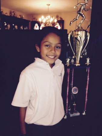 My student with her track trophy.  She's a very talented runner.