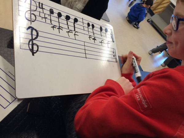 One of Izzy's students adding dynamics to a composition of his.