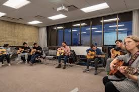 Group Guitar class for adults.